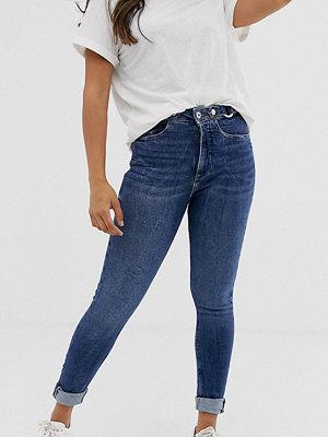 River Island Petite Mellanblå skinny jeans med slitna detaljer Mid auth