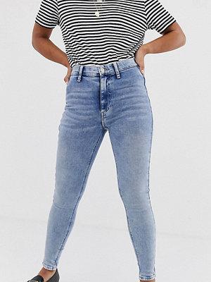 River Island Petite Kaia Ljustvättade skinny jeans Light auth