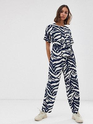 ASOS DESIGN Zebramönstrad minimalistisk overall med avtagbar magväska Zebra