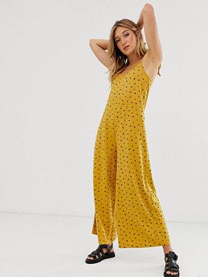 ASOS DESIGN Gul småmönstrad jumpsuit i minimalistisk design med knytning baktill i linneliknande tyg Småblommig/
