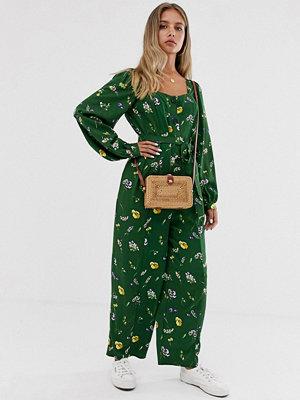 ASOS DESIGN Grönblommig jumpsuit med lång puffärm