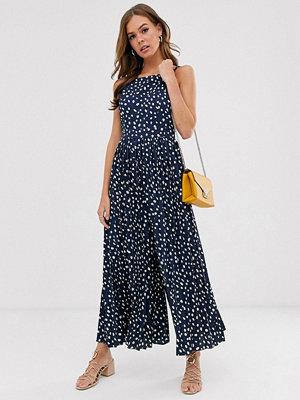 ASOS DESIGN Marinblå prickig plisserad jumpsuit med culottebyxor Marinblå med prickar