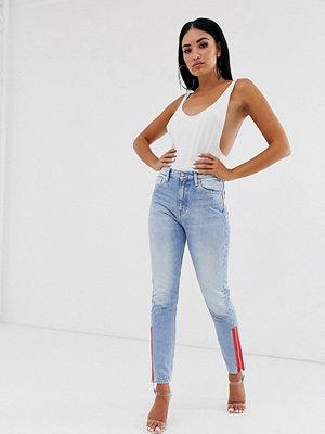 Calvin Klein 020 Höga slim jeans med röd dragkedja på sidan Apache blue tom zip