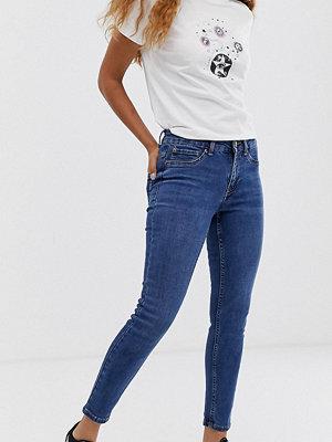 New Look Petite Mellanblå skinny jeans