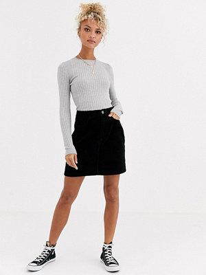 New Look Svart minikjol i manchester med fickor