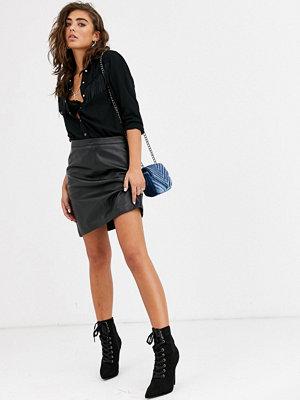 Object Minikjol i läder