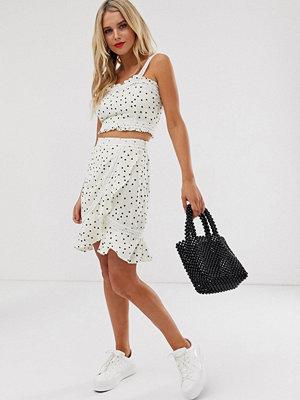 Glamorous Minikjol med spetsdetaljer och mönster med utspridda prickar