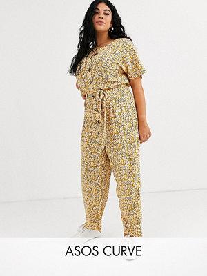 ASOS Curve Vintage-blommig jumpsuit med knappar framtill Blommig gul