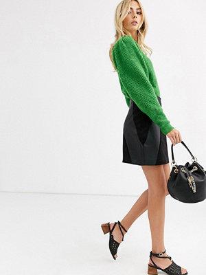Oasis Svart lappad minikjol i läderlook