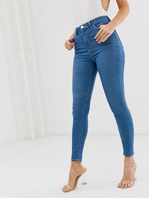 ASOS DESIGN Ridley Blå skinny jeans med hög midja och råskuren fåll Azurblå