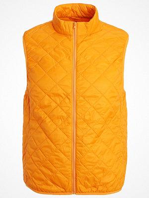 Västar - Benetton Väst orange