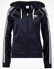 Adidas Originals SLIM FIT Tunn jacka dark blue