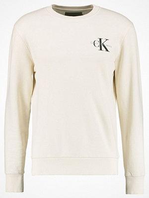 Tröjor & cardigans - Calvin Klein Jeans Sweatshirt beige
