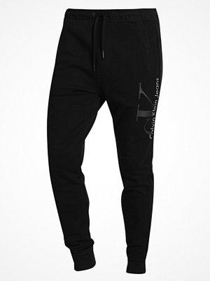 Sportkläder - Calvin Klein Jeans Träningsbyxor black