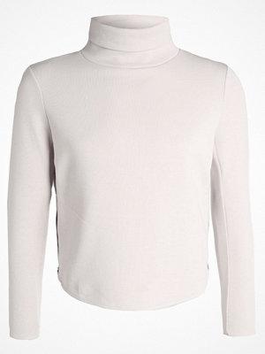 Sportkläder - Nike Performance THERMA Sweatshirt light orewood brown/black