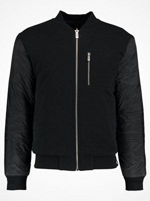 Calvin Klein Jeans HUSI REVERSIBLE Bomberjacka black