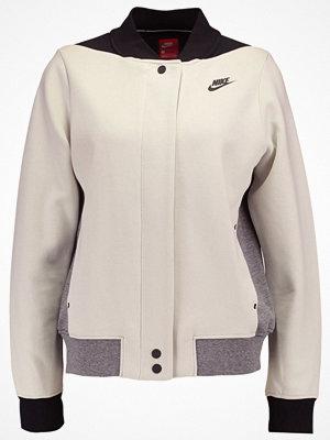 Nike Sportswear TECH FLEECE Bomberjacka light bone/carbon heather/black