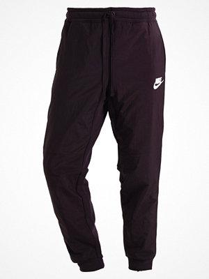 Nike Sportswear WINTER FLEECE Träningsbyxor port wine/white