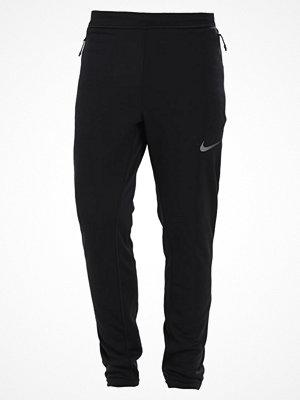 Nike Performance Träningsbyxor black/midnight fog/metallic hematite
