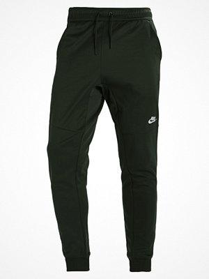 Nike Sportswear TRIBUTE Träningsbyxor outdoor green/white