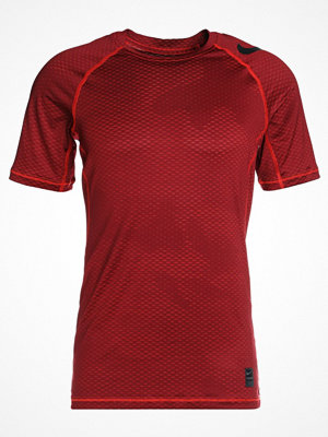 Nike Performance CAMO Tshirt med tryck habanero red/black