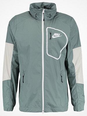 Nike Sportswear ADVANCE 15 Tunn jacka clay green/light bone/black/white