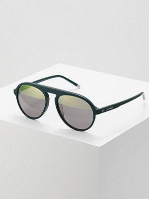 Calvin Klein Solglasögon dark green