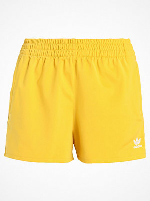 Adidas Originals ADICOLOR THREE STRIPES Träningsbyxor corn yellow