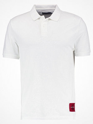 Pikétröjor - Calvin Klein Jeans PONTOS REGULAR FIT Piké bright white/tango red