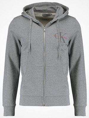 Street & luvtröjor - Calvin Klein Jeans HOMER ZIP THRU SLIM FIT Sweatshirt mid grey heather