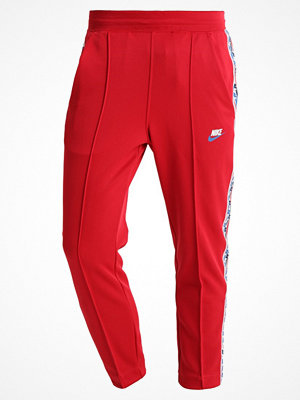 Nike Sportswear TAPED PANT POLY Träningsbyxor gym red/gym blue/sail