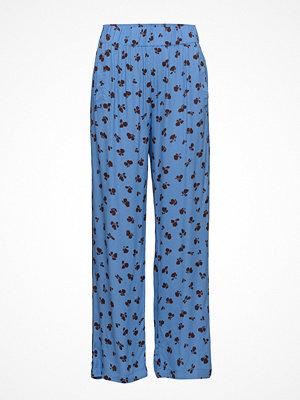 Ganni blå byxor med tryck Roseburg Crepe