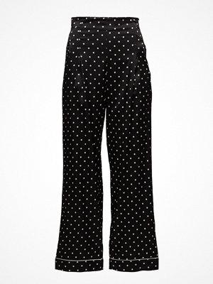 Ganni svarta byxor med tryck Dufort Silk