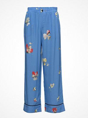 Ganni blå byxor med tryck Joycedale