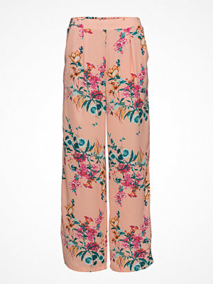 Tommy Jeans beige byxor med tryck Tjw Floral Print Pan