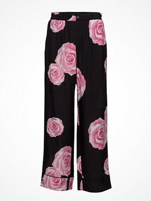 Ganni svarta byxor med tryck Fayette Silk