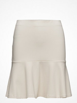 by Ti Mo Clean Flounce Skirt