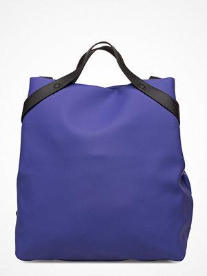 Rains marinblå ryggsäck Shift Bag