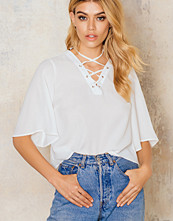 NA-KD Trend Woven Short Sleeve Lacing Top