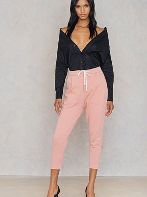 CHMPGN persikofärgade byxor Zipped Cropped Pants
