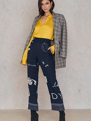 Stine Goya marinblå byxor med tryck Vinnie Pants