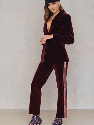 NA-KD Trend omönstrade byxor Velvet Striped Trousers