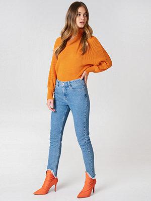 NA-KD Skinny Asymmetric Hem Denim - Jeans