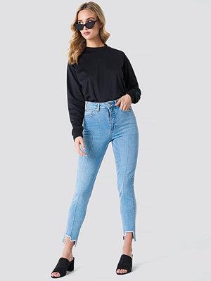 NA-KD High Rise Slim Asymmetric Hem Jeans