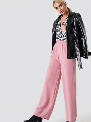 NA-KD Trend omönstrade byxor Wide Pants rosa