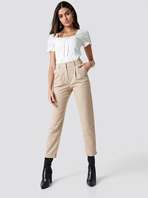 NA-KD Trend omönstrade byxor Cotton Blend Suit Pants beige