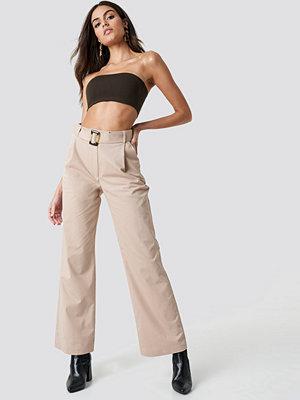 NA-KD Trend omönstrade byxor Wide Belted Cotton Blend Pants beige
