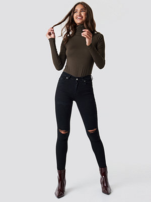 NA-KD Skinny Mid Waist Destroyed Jeans