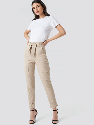 NA-KD Trend omönstrade byxor Tie Waist Patch Pocket Pants beige