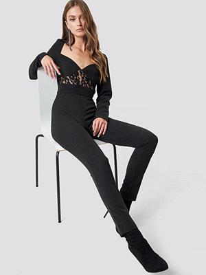 NA-KD Party Lace Insert LS Jumpsuit svart